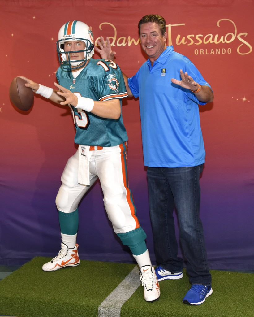 Dan Marino poses with his wax figure